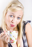 Beautiful woman drinking cup of tea with tea bag Royalty Free Stock Photo