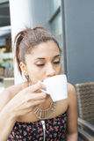 Beautiful woman drinking and enjoying a cup coffee. Stock Photos