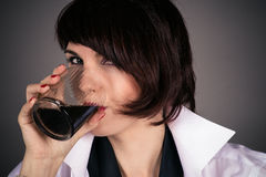 Beautiful woman is drinking Royalty Free Stock Photos