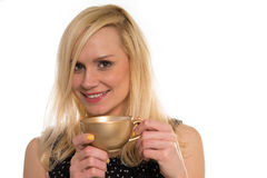 Beautiful woman drinking from a golden cup Stock Photos