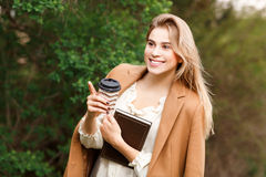 Beautiful woman  drinking her coffee Stock Images