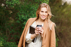 Beautiful woman  drinking her coffee Royalty Free Stock Photos