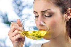 Beautiful woman drinking herbal tea Stock Photography