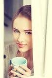 Beautiful woman drinking hot coffee or tea. Stock Photo