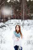 Beautiful woman drinking hot drink in winter park Royalty Free Stock Photos