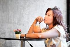 Beautiful woman drinking ice milk tea Stock Photo