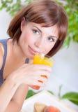 Beautiful woman drinking juice Royalty Free Stock Photo