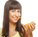 Beautiful woman drinking juice with straw. This image has attached release Stock Photos