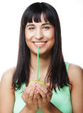 Beautiful woman drinking juice with straw Stock Images
