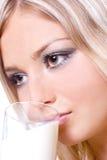 Beautiful woman drinking milk Stock Photos