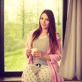 Beautiful woman drinking morning coffee. Stock Photos