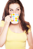 Beautiful woman drinking from a mug Royalty Free Stock Photography