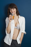 Beautiful woman drinking orange juice Stock Photo