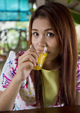 Beautiful woman is drinking orange juice. Stock Photography