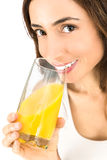 Beautiful woman drinking orange juice Royalty Free Stock Image