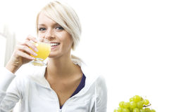 Beautiful woman drinking orange juice Royalty Free Stock Photography
