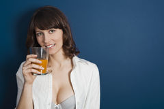Beautiful woman drinking orange juice Stock Images