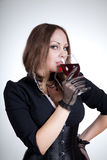 Beautiful woman drinking red wine Stock Photos