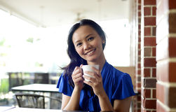 Beautiful woman drinking at the restaurant Stock Photo
