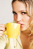 Beautiful woman drinking tea Royalty Free Stock Images