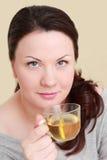 Beautiful woman drinking  tea Stock Images