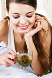 Beautiful woman drinking tea Royalty Free Stock Photo