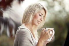 Beautiful woman drinking tea stock image