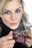 Beautiful woman drinking tea Stock Photos