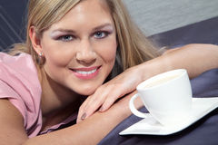 Beautiful woman drinking tea Stock Images