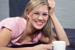 Beautiful woman drinking tea Stock Photography