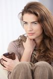 Beautiful woman drinking tea at home Stock Image