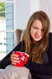 Beautiful woman drinking tea in the morning Stock Photography