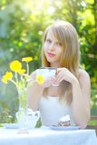 Beautiful woman drinking tea Stock Photo