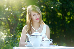 Beautiful woman drinking tea Stock Image