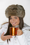 Beautiful woman drinking warm beverage Stock Image