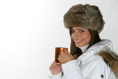 Beautiful woman drinking warm beverage Royalty Free Stock Photos