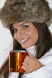 Beautiful woman drinking warm beverage Stock Photo