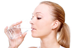 Beautiful woman drinking water stock photo