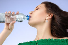 Beautiful woman drinking water Stock Images