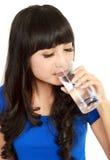 Beautiful woman drinking water Stock Photo