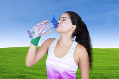 Beautiful woman drinking water on bottle Royalty Free Stock Photography