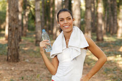 Beautiful woman drinking water from plastic bottles after running Royalty Free Stock Photo