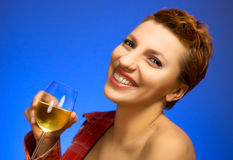 Beautiful woman drinking white wine Royalty Free Stock Photos