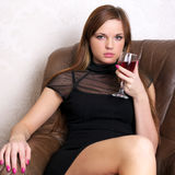 Beautiful woman drinking wine Stock Images