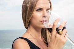 Beautiful woman drinking wine royalty free stock photo