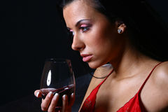 Beautiful woman drinkink wine s royalty free stock image