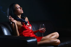 Beautiful woman drinkink wine s Stock Images