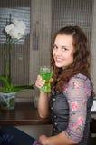 Beautiful woman drinks a cocktail Stock Photos