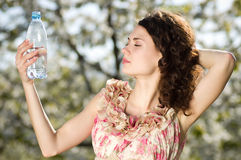 Beautiful woman drinks cold water Stock Photo