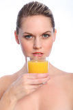 Beautiful woman drinks healthy orange fruit juice Royalty Free Stock Images